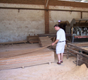 Brazilian hardwood decking being inspected by hand.